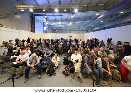 ZHUKOVSKY - JUNE 25: Photographers and journalists at second International Forum Engineering Technologies 2012, on June 25, 2012 in Zhukovsky near Moscow, Russia.