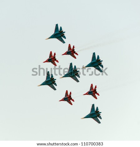 ZHUKOVSKY, MOSCOW REGION/RUSSIA - AUGUST 10: Diamond-shape of 5 Mig-29 Russian Knights and 4 Su-27 Swifts on airshow devoted to 100 anniversary of Russian Air Forces on August 10, 2012 in Zhukovsky.