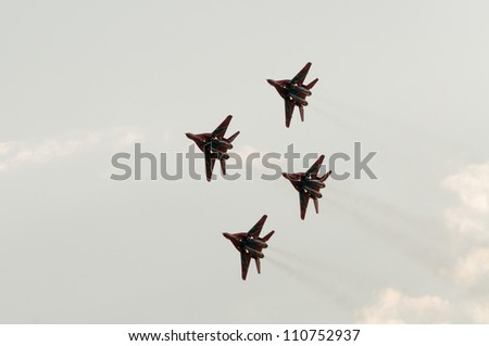 ZHUKOVSKY, MOSCOW REGION/RUSSIA - AUGUST 10: MiG-29 Fulcrum jet fighters of Swifts aerobatic team on airshow devoted to 100th anniversary of Russian Air Forces on August 10, 2012 in Zhukovsky.