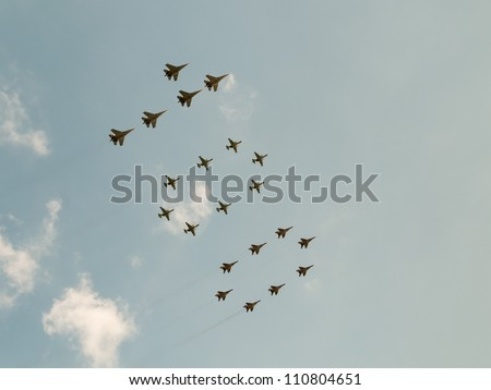 ZHUKOVSKY, MOSCOW REGION/RUSSIA - AUGUST 10: Number 100 made by  8 Mig-29SMT, 5 Su-27SM3 and 8 Su-25SM. Airshow devoted to 100th anniversary of Russian Air Forces on August 10, 2012 in Zhukovsky.