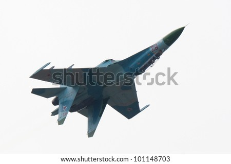 ZHUKOVSKY, RUSSIA - AUG 19: Su-27 from Russkie Vityazi aerobatic display team flies during airshow at International aviation and space salon MAKS 2011 on August 19, 2011 in Zhukovsky, Russia