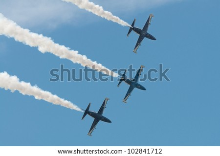 "ZHUKOVSKY, RUSSIA - AUG 19: The Aerobatic Team ""Vyazma"" performs acrobatics on the group of training aircraft at International aviation and space salon MAKS2011 on August 19, 2011 in Zhukovsky, Russia"