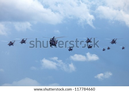ZHUKOVSKY, RUSSIA - AUG 11: The celebrating of the 100 anniversary of Russian air force. August, 11, 2012 at Zhukovsky, Russia. A group of helicopters in the sky