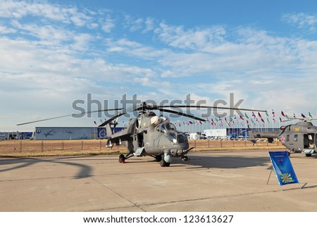 ZHUKOVSKY, RUSSIA - AUG 11: The Mil Mi-35 helicopter on celebrating of the 100 anniversary of Russian air force at August, 11, 2012 at Zhukovsky, Russia. - stock photo