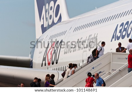 ZHUKOVSKY, RUSSIA - AUG 19: The people climb on board of Airbus A380 on display at International aviation and space salon MAKS 2011 on August 19, 2011 in Zhukovsky, Russia