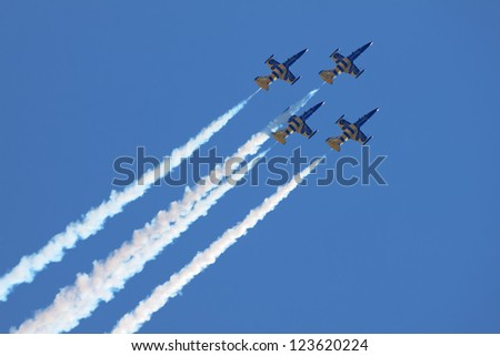 "ZHUKOVSKY, RUSSIA - AUGUST 19: Aerobatic team ""Baltic Bees"" at the International Aviation and Space salon (MAKS) on August 19, 2011 in Zhukovsky, Russia - stock photo"