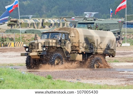 ZHUKOVSKY, RUSSIA - JULY 1: URAL-43206 army truck passes a water obstacle on the Forum ET-2012 on July 01, 2012 in Zhukovsky, Russia