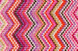Zig Zag abstract textured background of close detail of multicolored woven material