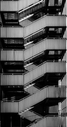 Zig-zag fire escape stairs on the back of a building