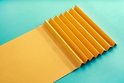 Zig Zag fold paper texture background, Yellow Zigzag paper with blue paper pattern paper background