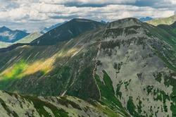 Zig zag hiking trail on top Jarzabczy Wierch (Hruby vrch). Border Poland and Slovakia, Tatras. Carpathian, Europe. Magical mountain landscape.