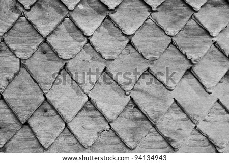 Zig zag lines of the roof made ??of wood, Natural textured background Black and white image. - stock photo