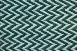Zig zag of white and green on fabric