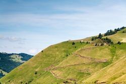Zig zag road to a house in the mountain. Vega de Pas, Cantabria (Spain)
