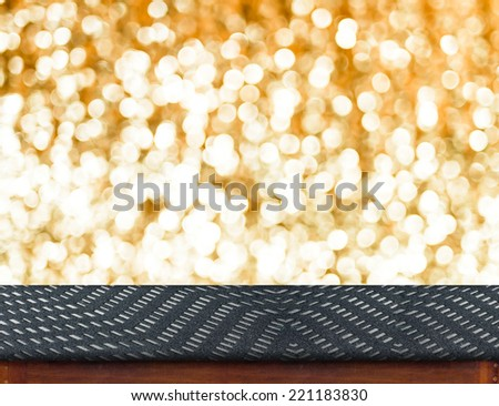 Zigzag fabric Table with bokeh golden sparkling background,Empty room for display your product