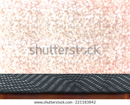 Zigzag fabric Table with bokeh pink sparkling background,Empty room for display your product