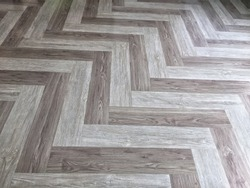Zigzag pattern of grey wood grain vinyl tiles flooring texture background