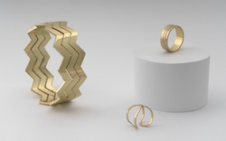 Zigzag shape modern golden bracelet with two rings on white