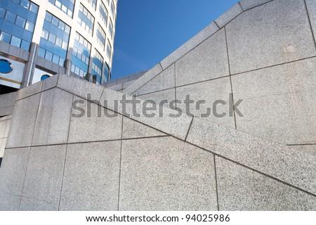 zigzags of outdoor granite stairways - stock photo