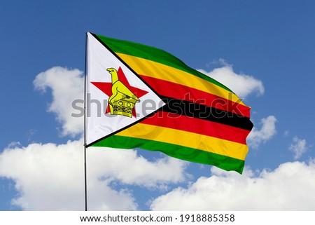 Zimbabwe flag isolated on the blue sky with clipping path. close up waving flag of Zimbabwe. flag symbols of Zimbabwe. Zdjęcia stock ©