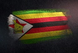 Zimbabwe Flag Made of Metallic Brush Paint on Grunge Dark Wall
