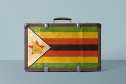 Zimbabwe flag on old vintage leather suitcase with national concept. Retro brown luggage with copy space text.
