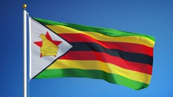 Zimbabwe flag waving against clean blue sky, close up, isolated with clipping path mask alpha channel transparency
