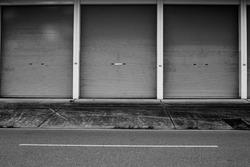 zinc door background, metallic roll up door near street, black and white