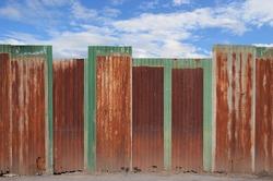 zinc fence on blue sky background