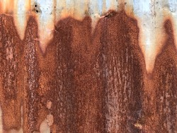 Zinc galvanized coating sheet surface with rust stains and cracks for background and texture. Zinc corrodes when exposed to air and moisture. Damaged metal sheet roof by rust. (space for text design)