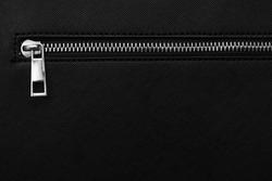 Zip fastener on black women's handbag with copy space