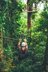 Zip line adventure in rainforest tropical jungle.
