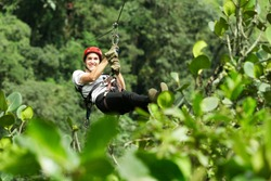 zip line jungle adventure rain forest canopy man gliding cable adult man on zipline andes rainforest in ecuador zip line jungle adventure rain forest canopy man gliding cable satisfied race zipline ca