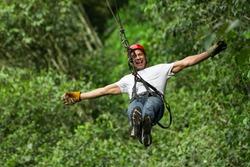 zip line ziplin adventure man adrenalin adult sport forest entertainment mature male on zipline ecuadorian andes zip line ziplin adventure man adrenalin adult sport forest entertainment journey race z