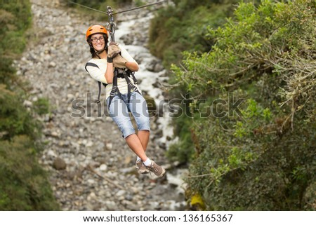 Zipline adventure in Ecuadorian rainforest, Banos de Agua Santa - stock photo