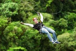 zipline canopy zip line wire adventure jungle forest sport flight mature masculine pilgrim wearing informal linen on zipline or canopi experience in ecuadorian rain forest zipline canopy zip line wire