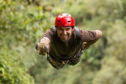 zipline zip wire line superman superhuman canopy man activity tourism zip line adventure in ecuadorian rainforest, banos de agua santa zipline zip wire line superman superhuman canopy man activity tou