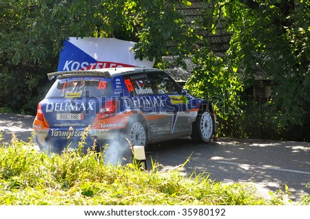 ZLIN, CZECH REP. - AUGUST 23, Driver Valousek Pavel and co-driver Hruza Zdenek in car Skoda Fabia S2000 at speed stage no.10 during Barum Czech Rally August 23, 2009 in Zlin, Czech Rep.