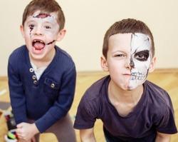 zombie apocalypse kids concept. Birthday party celebration facepaint on children dead bride, scar face, skeleton together having fun
