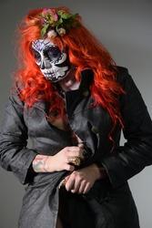 Zombie girl. Stodio portrait of female model with creative Halloween makeup. Halloween concept