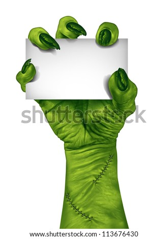 Zombie hand holding a blank sign card as a creepy halloween or scary symbol with textured green skin wrinkled monster fingers and stitches isolated on a white background..
