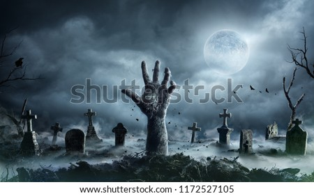 Zombie Hand Rising Out Of A Graveyard In Spooky Night  #1172527105