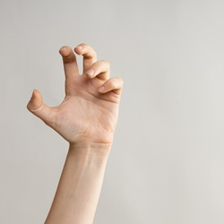 Zombie hands attack, grabbing something hands with crooked fingers. Hand gestures, light grey background