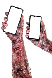 zombie or undead hands holding cell phone, copy space for text