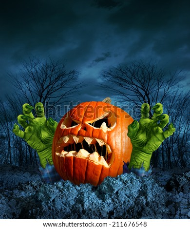 Zombie pumpkin halloween greeting card with copy space as a scary surprise creepy jack o lantern with monster green hands rising from the dead on a dark cold haunted autumn night