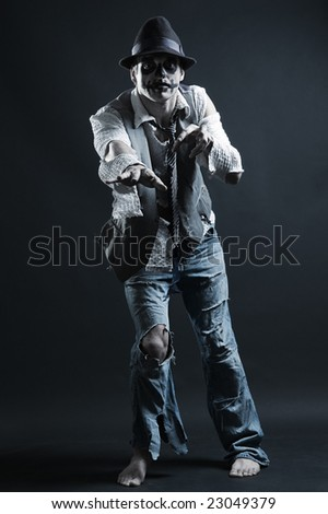 zombie reaching to you over dark background - stock photo