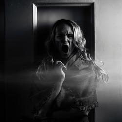 Zombies scream halloween concept, make-up girl without eyes.Young blond terrible woman