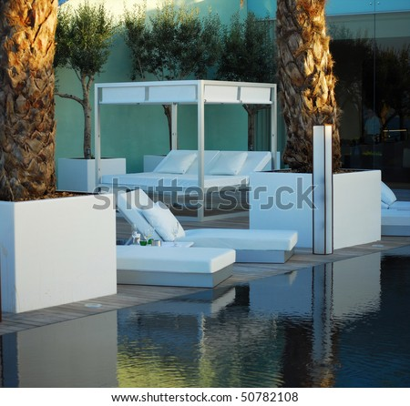 zone of rest and bar with pool in modern hotel of barcelona, spain, catalonia