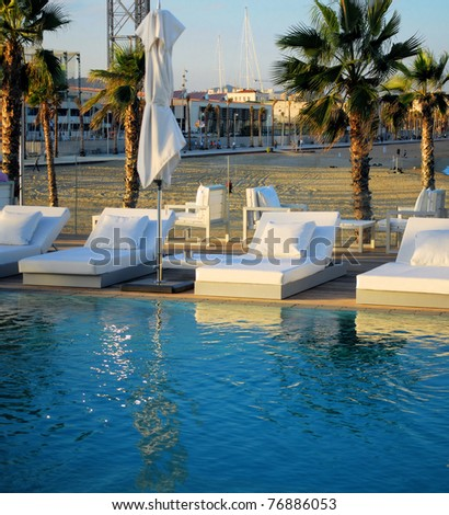 zone of rest with pool on quay of mediterranean sea in barcelona, spain