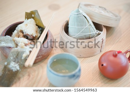 Zongzi. Zongzi served with Chinese traditional tea, Zongzi is traditional Chinese glutinous rice with different fillings such as pork, peanuts, mushroom and ginkgo. #1564549963